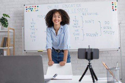 teacher using computer presentation and webcam for education